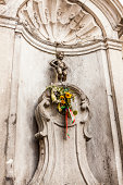 Manneke Pis doing what he does