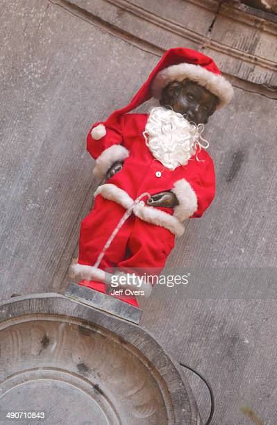Mannekin Pis dressed as Santa for Christmas Mannekin Pis is a fountain made of a statue of a small boy urinating Brussels Belgium