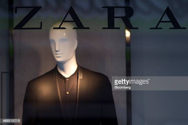 A mannequin advertises men's clothing in the window of a Zara fashion store operated by Inditex SA in La Coruna Spain on Thursday Feb 13 2014 Inditex...