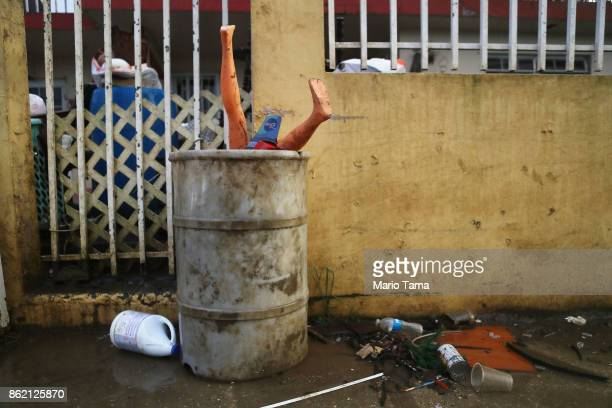 A mannequin and other items and debris are discarded on a sidewalk on October 16 2017 in Toa Baja Puerto Rico Puerto Rico is suffering shortages of...