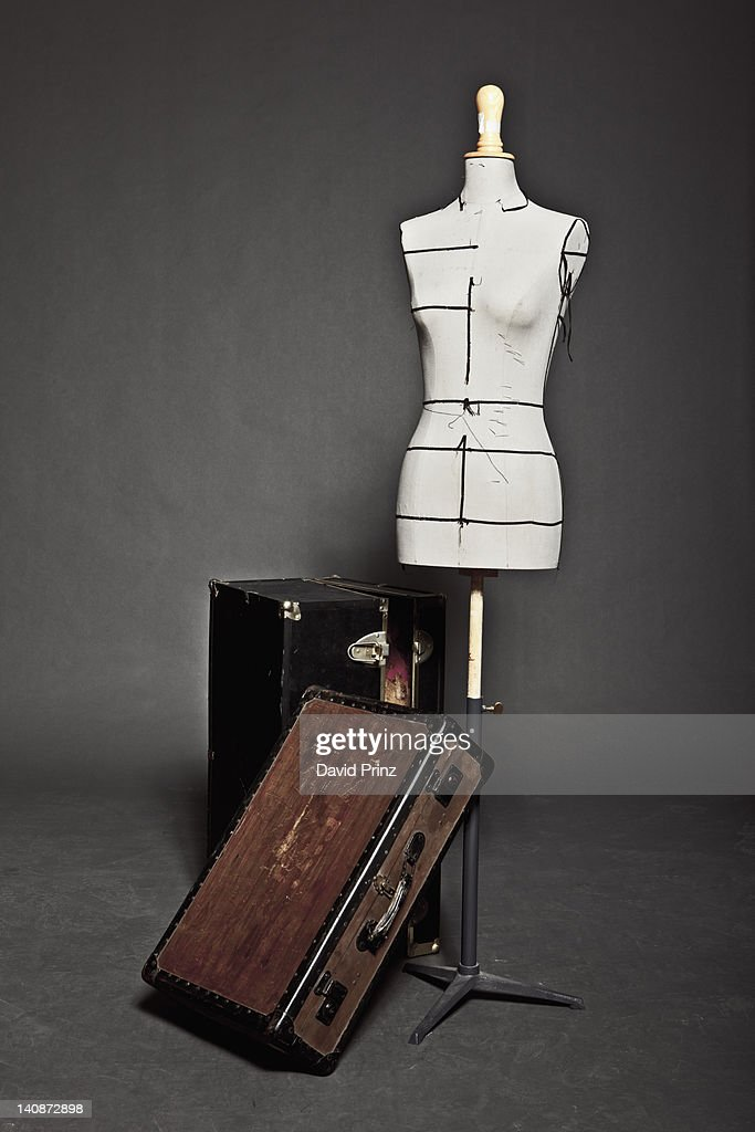 Mannequin and vintage trunks : Stock Photo