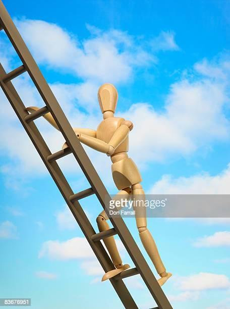 mannequin ascending a ladder