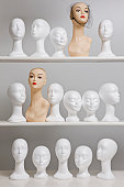 Mannequin busts on shelves