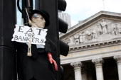 A mannequin dressed as a banker is hanged from traffic light post outside the Bank of England during G20 demonstrations in the City of London on...