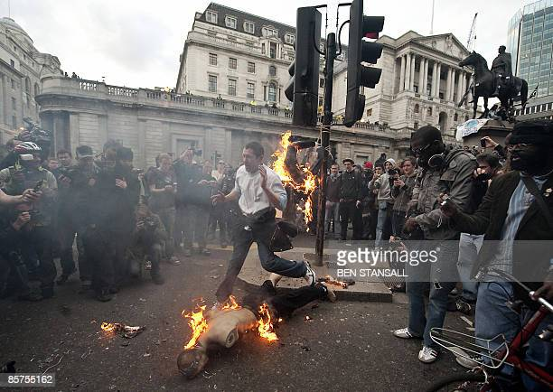 A mannequin dressed as a city worker is set on fire by protestors during an anti G20 demonstration near the Bank of England in London on April 1 2009...