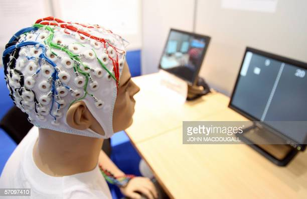 A mannequin is fitted with a prototype of a 'mental typewriter' which is an EEG Cap that processes electric impulses from the brain into commands for...
