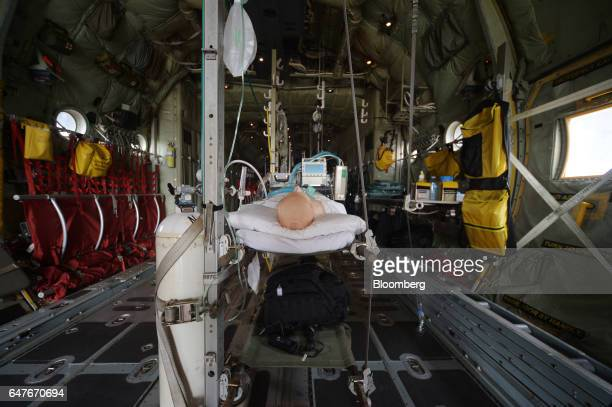 A mannequin lies on a bed during a demonstration of a medical set up onboard an Australian Defence Force C130J Super Hercules turboprop military...