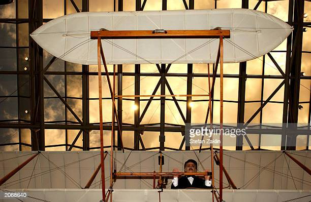A mannequin of Orville Wright illustrates how the original Wright Flyer was flown at the Smithsonian National Air and Space Museum June 9 2003 in...