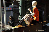 A mannequin sits in the window of a store on March 12 2015 in New York City For a third straight month in February US retail sales unexpectedly fell...
