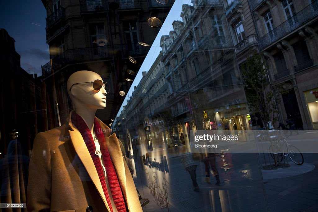 A mannequin stands the window display of a Massimo Dutti fashion clothing store, a division of Inditex SA, in Toulouse, France, on Wednesday, Nov. 20, 2013. France's gross domestic product fell 0.1 percent in the three months through September, national statistics office Insee said in an e-mailed statement. Photographer: Balint Porneczi/Bloomberg via Getty Images