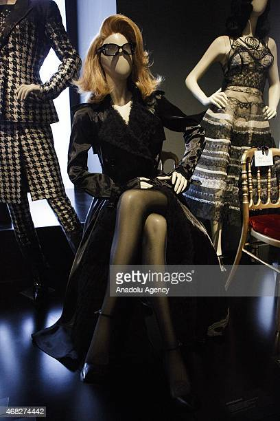 A mannequin wearing a Catherine Deneuve costume is seen during an exhibition by French fashion designer JeanPaul Gaultier at the Grand Palais in...