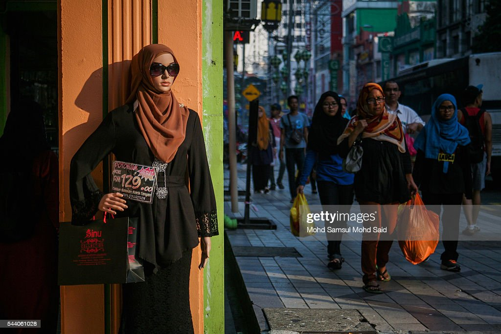 A mannequin with muslim modern clothes style is seen in downtown ahead of the Eid al-Fitri festival on July 1, 2016 in Kuala Lumpur, Malaysia. Southeast Asia's Muslims are observing the fasting month of Ramadan, Islam's holiest month, during which observant believers fast from dawn to dusk. Malaysia Muslims spend extra on food and new clothes for Eid al-Fitr, the most important festival in Islam, which marks the end of Ramadan spending seems to be holding up in Malaysia and in neighbouring Indonesia, which together account for about 14 percent of the world's Muslims.