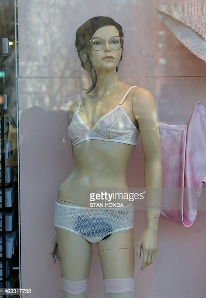 A mannequin with pubic hair is displayed in the window of an American Apparel shop on Houston Street in the Soho section of Manhattan January 17 2014...
