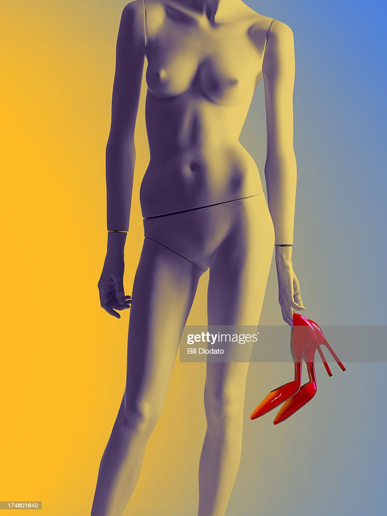 Mannequin with shoes in hand : Stock Photo