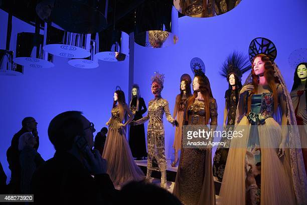 Mannequins are seen during an exhibition by French fashion designer JeanPaul Gaultier at the Grand Palais in Paris on April 1 2015