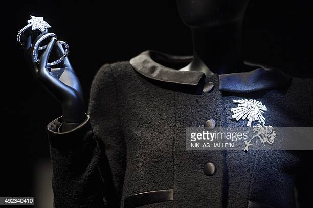 Mannequins display black outfits and jewellery from French fashion house Chanel's 1932 collection during a pressview of 'Mademoiselle Privé' a joint...