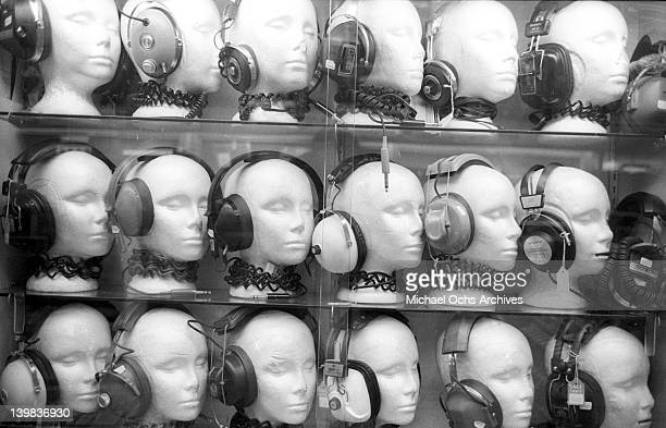 Mannequins display vintage headphones in a storefront window on March 26 1969 in San Diego California