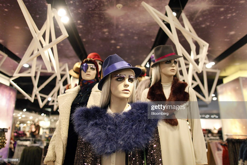 Mannequins display women's clothes and hats inside a Topshop store, owned by Arcadia Group Ltd., on Oxford Street in London, U.K., on Thursday, Dec. 6, 2012. Philip Green, the billionaire owner of the Arcadia fashion business, sold a 25 percent stake in the Topshop and Topman retail chains to Leonard Green & Partners LP, the co-owner of the J Crew fashion brand, in a deal valuing the businesses at 2 billion pounds ($3.2 billion). Photographer: Simon Dawson/Bloomberg via Getty Images