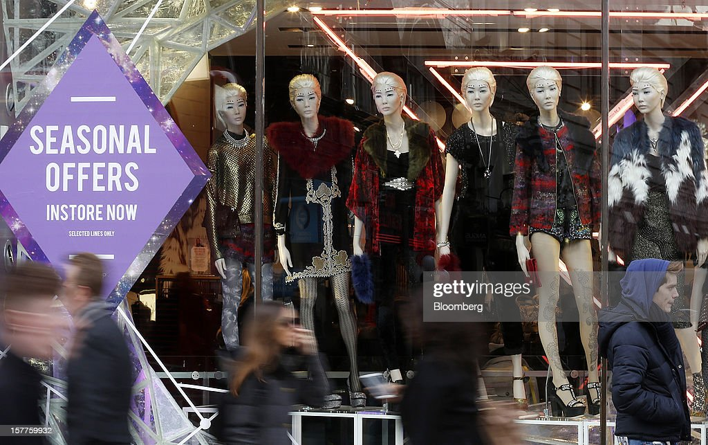 Mannequins display women's clothes in the window display of a Topshop store, owned by Arcadia Group Ltd., on Oxford Street in London, U.K., on Thursday, Dec. 6, 2012. Philip Green, the billionaire owner of the Arcadia fashion business, sold a 25 percent stake in the Topshop and Topman retail chains to Leonard Green & Partners LP, the co-owner of the J Crew fashion brand, in a deal valuing the businesses at 2 billion pounds ($3.2 billion). Photographer: Simon Dawson/Bloomberg via Getty Images