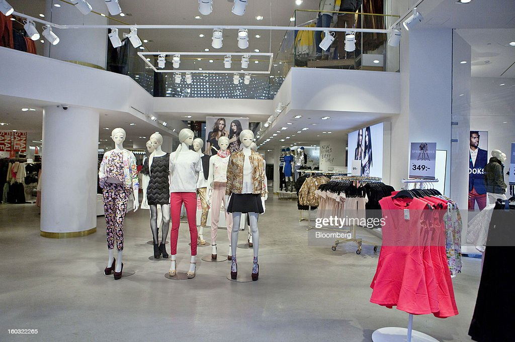 Mannequins displaying women's clothing stand inside a Hennes & Mauritz AB (H&M) store in Stockholm, Sweden, on Tuesday, Jan. 29, 2013. Hennes & Mauritz AB, Europe's second-largest clothing retailer, reported sales growth that beat analysts' estimates for a second consecutive month as the chain offered markdowns in advance of the Christmas holiday. Photographer: Casper Hedberg/Bloomberg via Getty Images
