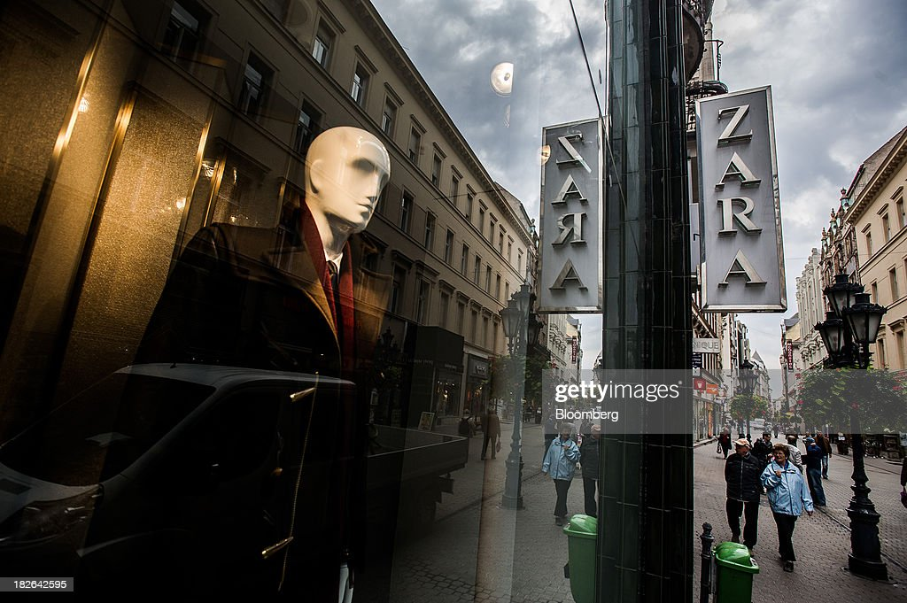 Mannequins displays mens clothing for sale in the window of a Zara fashion store, operated by Inditex SA, in Budapest, Hungary, on Wednesday, Oct. 2, 2013. 'The retail sales environment in Europe, especially in Spain, has become less challenging in the last few weeks, while the weather overall has also been more stable,' Anne Critchlow, a London-based analyst at Societe Generale, said. Photographer: Akos Stiller/Bloomberg via Getty Images
