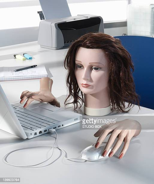 Mannequin's head and hands at workstation