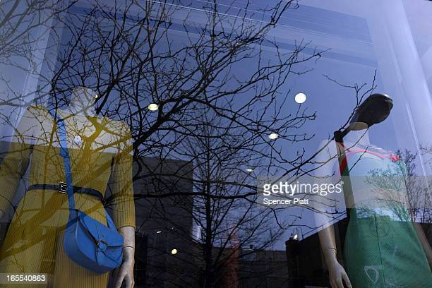 Mannequins stand behind a window of a clothing store window along a street in the rapidly developing neighborhood of Williamsburg on April 4 2013 in...