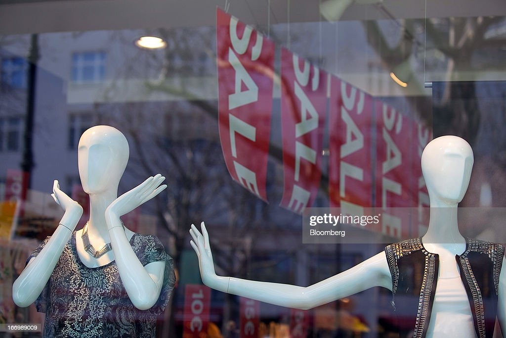 Mannequins stand in a retail store window alongside a 'Sale' sign offering discounted goods in Berlin, Germany, on Thursday, April 18, 2013. Germany's economy is shrugging off a contraction at the end of last year and starting to grow due to revived exports and rising private consumption, the country's leading economic institutes said. Photographer: Krisztian Bocsi/Bloomberg via Getty Images