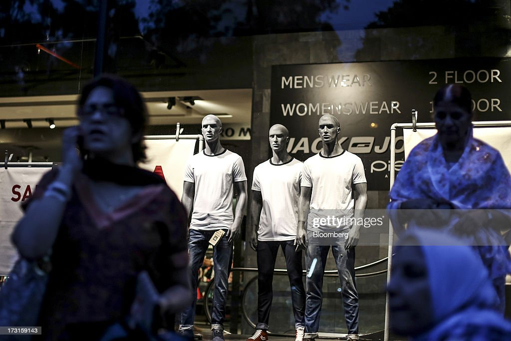 Mannequins stand in the window display of a Jack & Jones AB Clothes store, operated by Bestseller AS, in the suburb of Bandra in Mumbai, India, on Saturday, July 6, 2013. India's consumer price index (CPI) figures for June are scheduled to be released on July 12. Photographer: Dhiraj Singh/Bloomberg via Getty Images