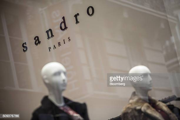 Mannequins stand in the window of a Sandro luxury clothing store operated by SMCP Group in Toulouse France on Wednesday Feb 10 2016 Shandong Ruyi...