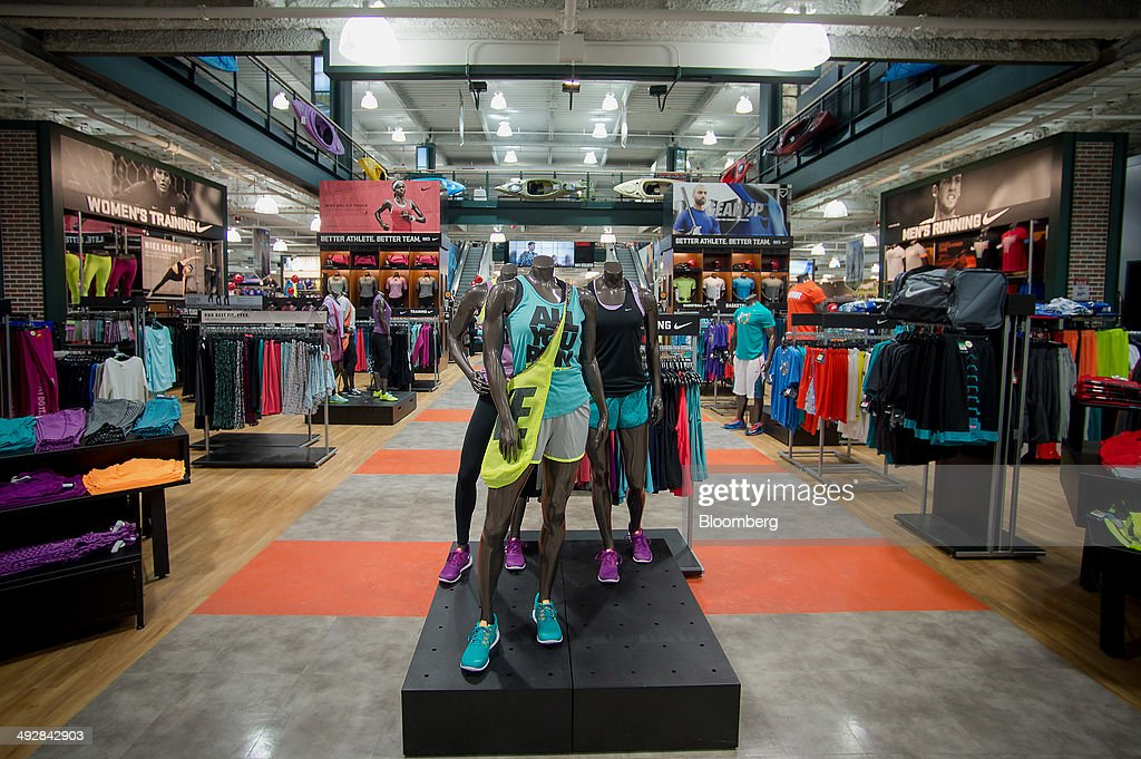 Mannequins stand next to merchandise displayed for sale at a Dick's Sporting Goods Inc store in West Nyack New York US on Wednesday May 21 2014...
