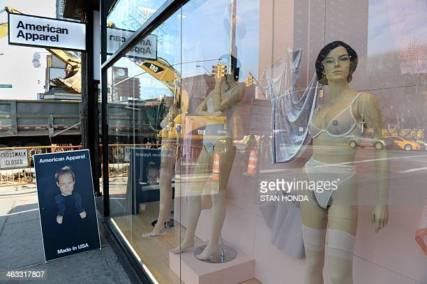 Mannequins with pubic hair are displayed in the window of an American Apparel shop on Houston Street in the Soho section of Manhattan January 17 2014...