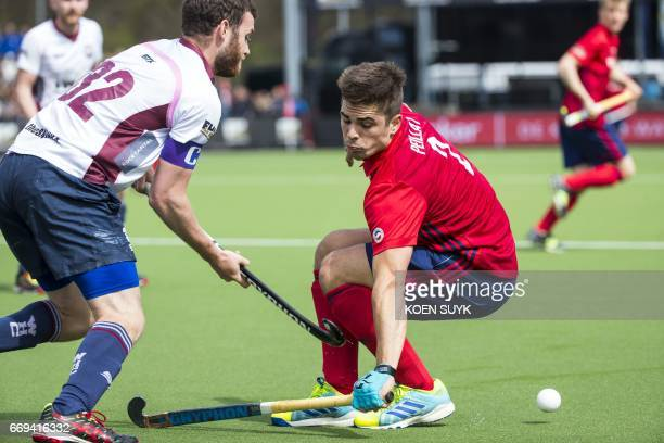 Mannheimer's Gonzalo Peillat vies for the ball with Wimbledon's John Kinder during the quarter final hockey match between Wimbledon and Mannheimeron...