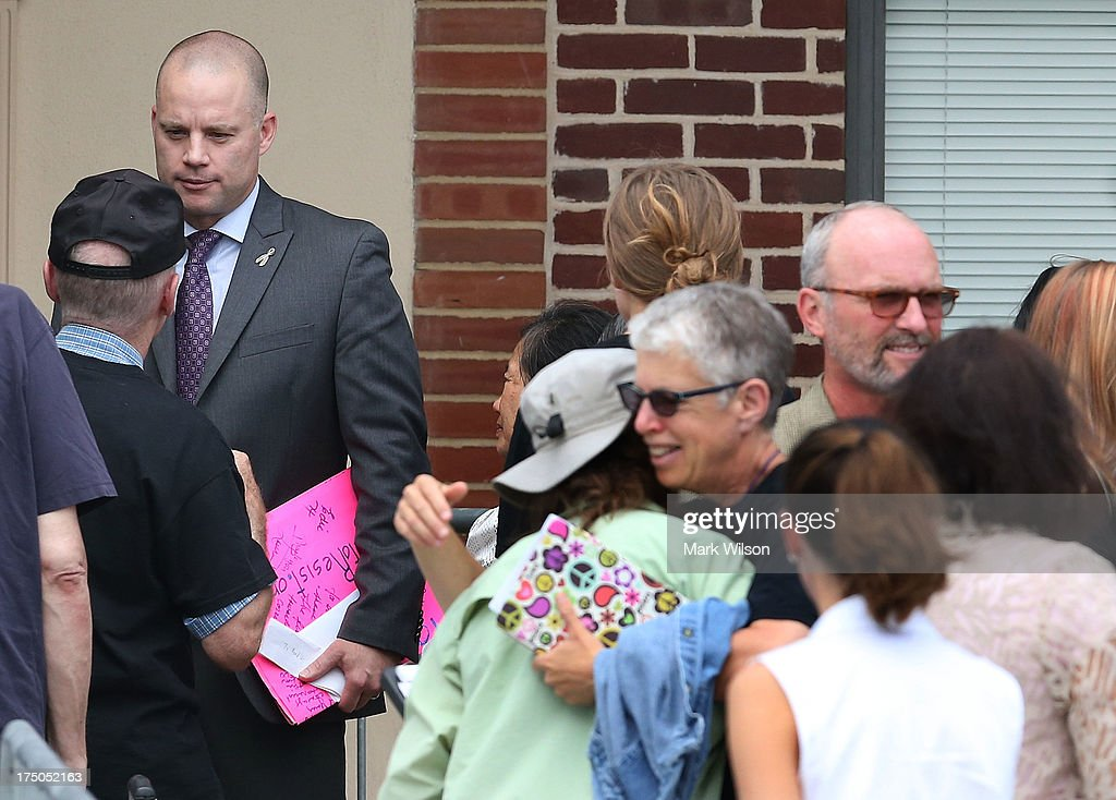 Manning attorney David Coombs (L) greets supporters after U.S. Army Private First Class Bradley Manning was found guilty of 20 out of 21 charges, July 30, 2013 at Fort George G. Meade, Maryland. Manning, was found not guilty of aiding the enemy, was convicted of wrongfully causing intelligence to be published on the internet, is accused of sending hundreds of thousands of classified Iraq and Afghanistan war logs and more than 250,000 diplomatic cables to the website WikiLeaks while he was working as an intelligence analyst in Baghdad in 2009 and 2010.
