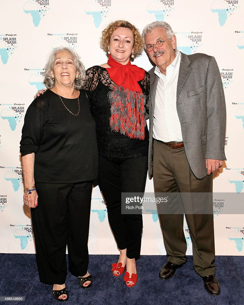 Manny and Jackie Silverman flank The Samburu Projects Board Chair Linda Hooper arrive at the Samburu Splash Bash Event on September 27 2014 in Santa...