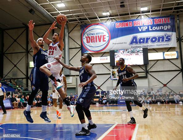 Manny Atkins of the Grand Rapids Drive tries to get to the basket past Jarnell Stokes of the Iowa Energy during a NBA Development League game on...
