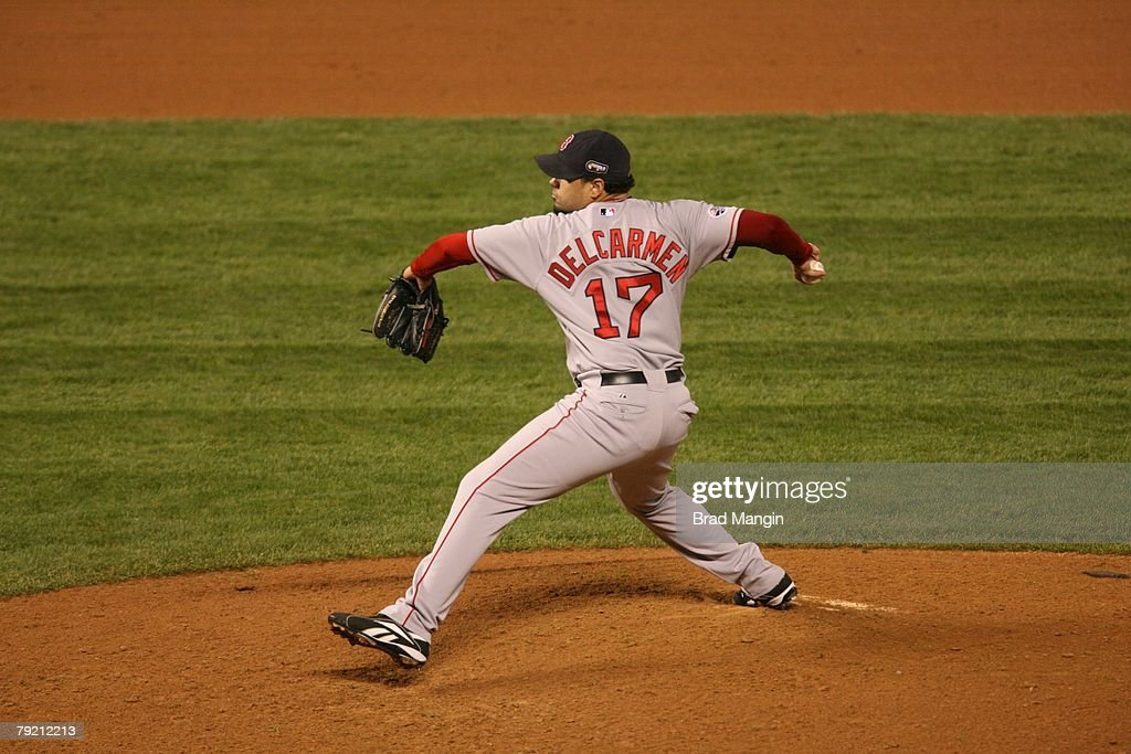 Manny Delcarmen of the Boston Red Sox pitches during Game Three of the World Series against the Colorado Rockies at Coors Field in Denver, Colorado on October 27, 2007. The Red Sox defeated the Rockies 10-5.