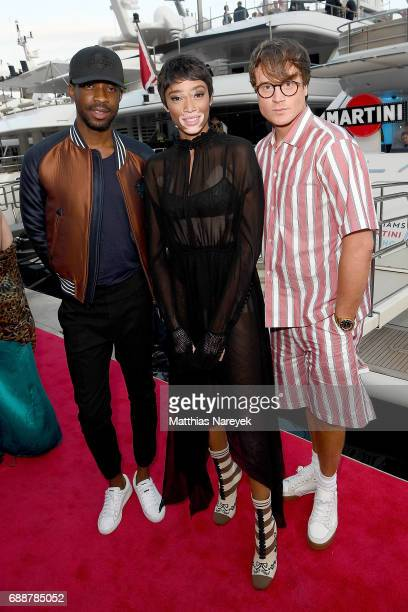 Manny Ezugwu Winnie Harlow and Laurie Calvert celebrate the Monaco Grand Prix at the Martini Yacht Party on May 26 2017 in Monte Carlo Monaco