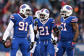 Manny Lawson of the Buffalo Bills is congratulated by Leodis McKelvin of the Buffalo Bills and Kevin Reddick of the Buffalo Bills after an...