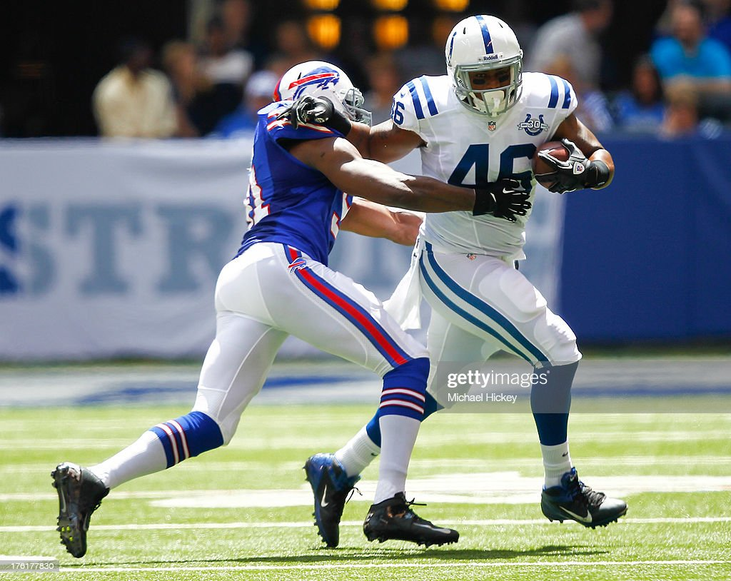 <a gi-track='captionPersonalityLinkClicked' href=/galleries/search?phrase=Manny+Lawson&family=editorial&specificpeople=592535 ng-click='$event.stopPropagation()'>Manny Lawson</a> #91 of the Buffalo Bills tries to tackle <a gi-track='captionPersonalityLinkClicked' href=/galleries/search?phrase=Dominique+Jones+-+Basketball+Player&family=editorial&specificpeople=4782614 ng-click='$event.stopPropagation()'>Dominique Jones</a> #46 of the Indianapolis Colts at Lucas Oil Stadium on August 11, 2013 in Indianapolis, Indiana.