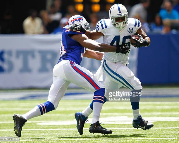 Manny Lawson of the Buffalo Bills tries to tackle Dominique Jones of the Indianapolis Colts at Lucas Oil Stadium on August 11 2013 in Indianapolis...