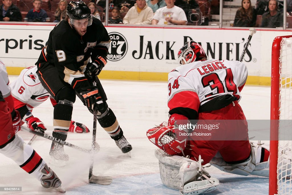 Manny Legace of the Carolina Hurricanes defends in the crease from a shot from Bobby Ryan of the Anaheim Ducks during the game on November 25 2009 at...