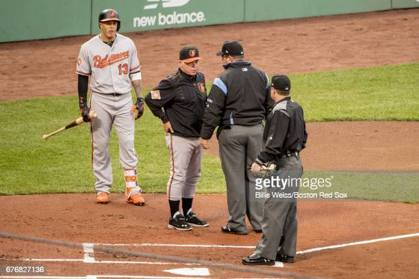 Manny Machado and manager Buck Showalter of the Baltimore Orioles argue with the umpires after a pitch was thrown behind the back of Machado by Chris...