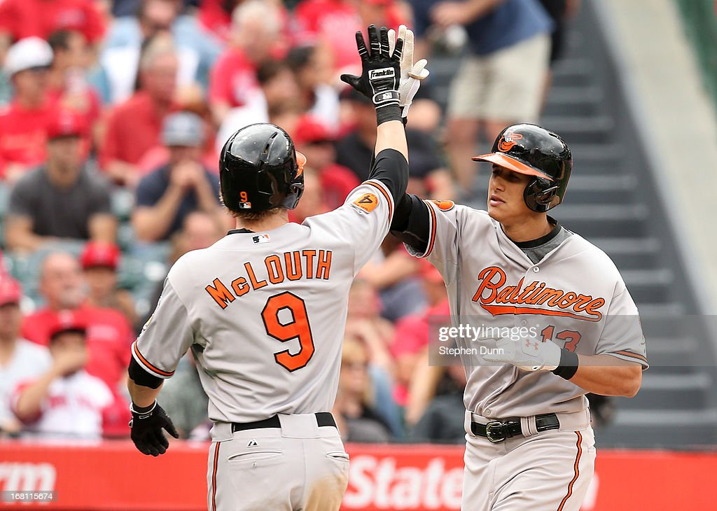 <a gi-track='captionPersonalityLinkClicked' href=/galleries/search?phrase=Manny+Machado&family=editorial&specificpeople=5591039 ng-click='$event.stopPropagation()'>Manny Machado</a> #13 and <a gi-track='captionPersonalityLinkClicked' href=/galleries/search?phrase=Nate+McLouth&family=editorial&specificpeople=536572 ng-click='$event.stopPropagation()'>Nate McLouth</a> #9 of the Baltimore Orioles celebrate after both score on Machado's two run home run in the fifth inning against the Los Angeles Angels of Anaheim at Angel Stadium of Anaheim on May 5, 2013 in Anaheim, California.