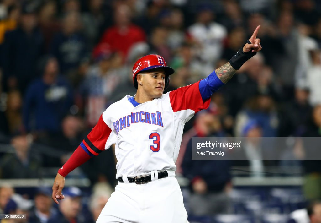 Manny Machado #3 of Team Dominican Republic reacts after scoring in the bottom of the first inning of Game 6 of Pool F of the 2017 World Baseball Classic against Team USA on Saturday, March 18, 2017 at Petco Park in San Diego, California.