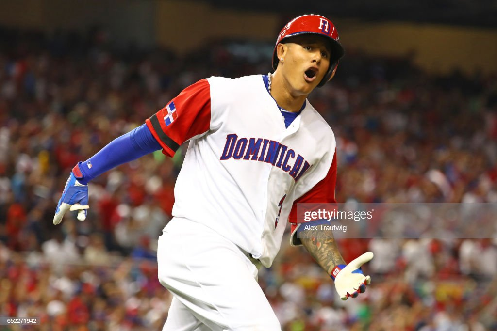 a7d50be36 ... Jersey Manny Machado 3 of Team Dominican Republic reacts to hitting a  solo home run in Mens Dominican Republic Baseball Majestic Royal 2017 World  ...