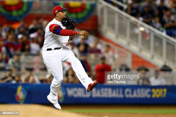 Manny Machado of Team Dominican Republic turns a double play during to Game 1 of Pool C of the 2017 World Baseball Classic against Team Canada on...