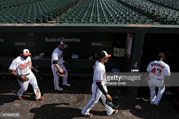 Manny Machado of the Baltimore Orioles and teammates walk into the club house after defeating the Chicago White Sox at an empty Oriole Park at Camden...