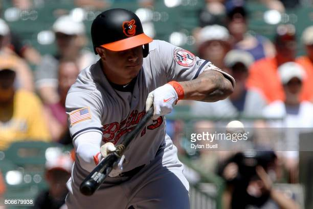 Manny Machado of the Baltimore Orioles attempts a bunt in the first inning against the Milwaukee Brewers at Miller Park on July 3 2017 in Milwaukee...