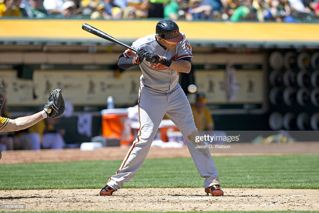 <a gi-track='captionPersonalityLinkClicked' href=/galleries/search?phrase=Manny+Machado&family=editorial&specificpeople=5591039 ng-click='$event.stopPropagation()'>Manny Machado</a> #13 of the Baltimore Orioles avoids an inside pitch from A.J. Griffin #64 of the Oakland Athletics (not pictured) to draw a walk during the fourth inning at O.co Coliseum on April 27, 2013 in Oakland, California.
